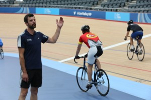 Bringing riders off the track. Hand signals are always useful for getting your message across!