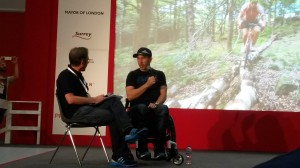Martyn being interviewed on stage-here talking about Chris Akrigg riding along a tree on a road bike!